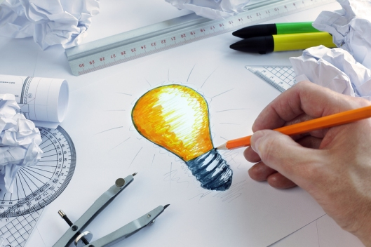 bigstock-Designer-drawing-a-light-bulb-59047460.jpg